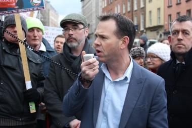 John Brady TD addressing the crowd outside Leinster House at today's pension demonstration