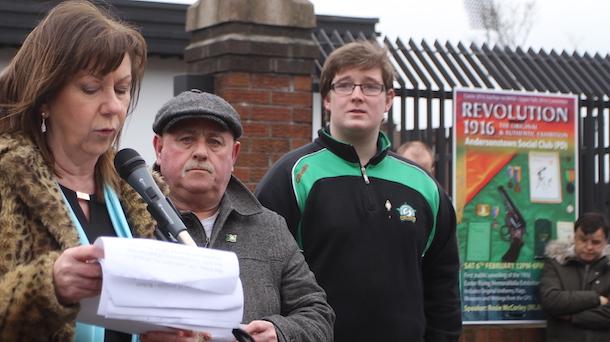 Rosie McCorley MLA addresses the crowd as  Seán 'Ginty' Lennon and Naoise Ó Faoláin look on
