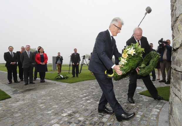 Sinn Féin's Martin McGuinness (right) lays a wreath at the Somme Memorial in Flanders as DK and Sinn Féin deputy leader Mary Lou McDonald look on