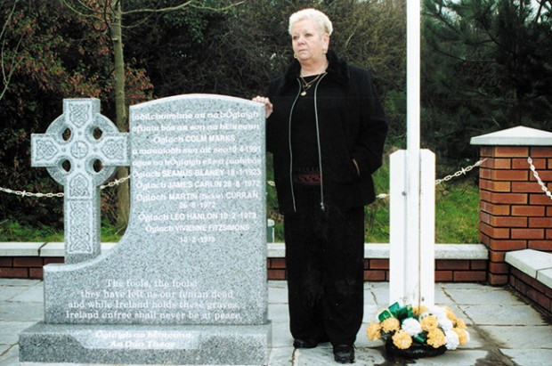 Colum Marks's mother, Roisín, stands at the memorial to Volunteers from South Down