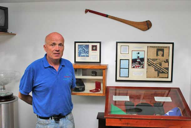 Seán with 1981 hunger striker Kevin Lynch's beret, gloves and flag, his hurl and All-Ireland medal in the Dungiven Museum