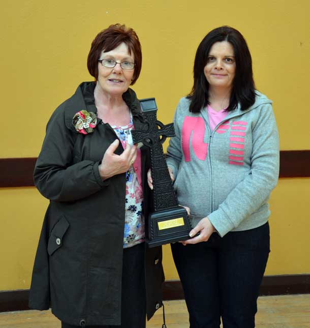 Anne Caldwell (left), cousin of Tobias, is presented with an inscribed Celtic cross by Molloy/Devlin/McCauley Sinn Féin Cumann member Anne-Marie Love on behalf of the Sinn Féin Tyrone Commemoration Committee