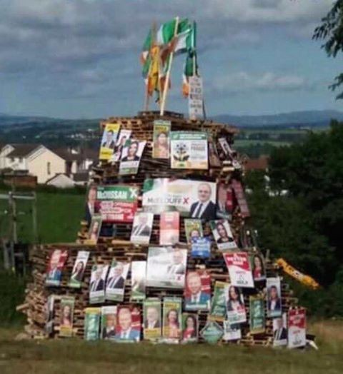 Election posters on a loyalist bonfire.