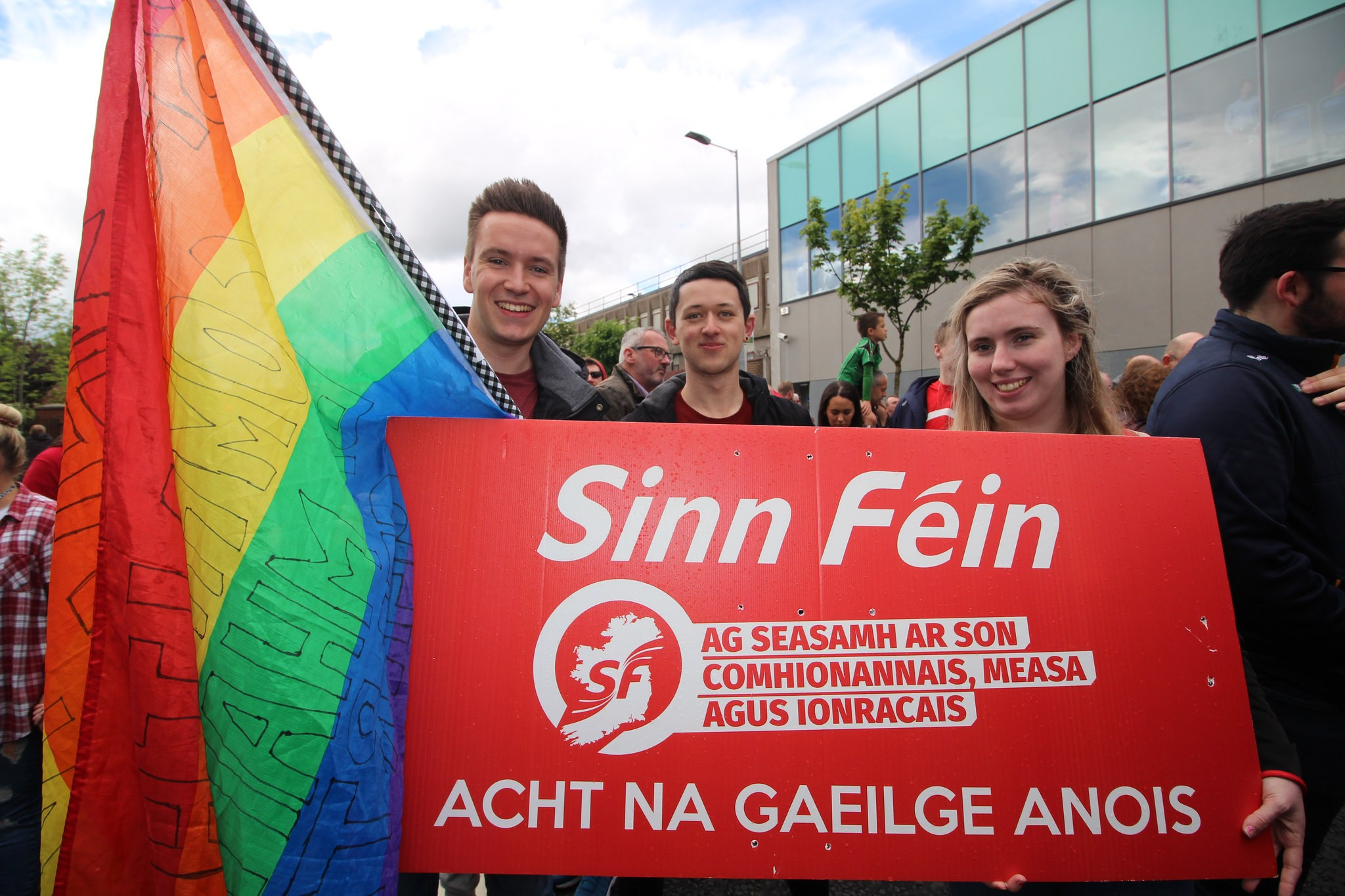 Sinn Féin activists campaigning for marriage equality and an Irish language act.