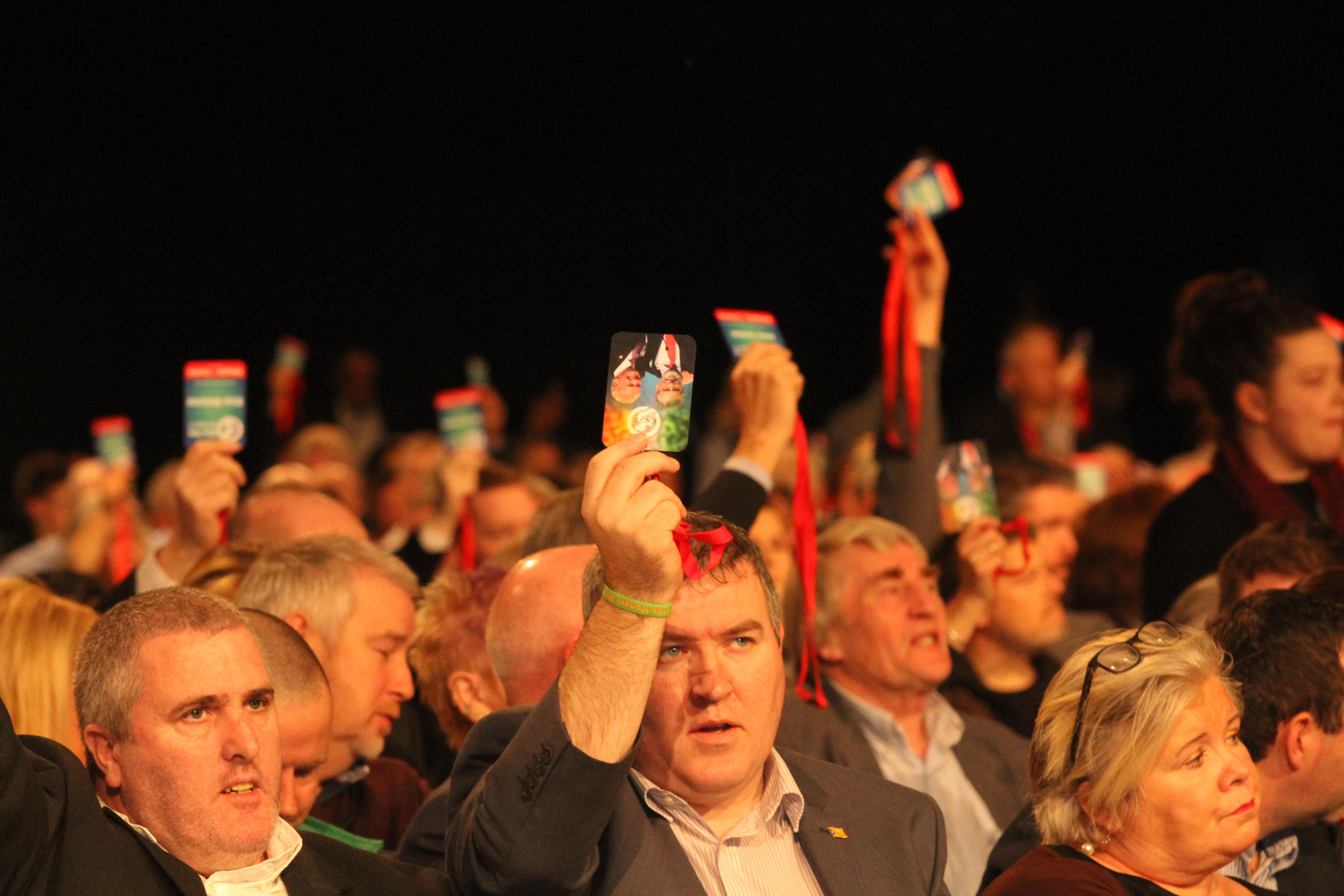 Delegates voting of policy at a Sinn Féin Ard Fheis.