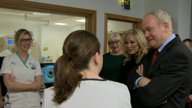 The late Martin McGuinness and then Health Minister Michelle O'Neill speaking to staff at the North West Cancer Centre.