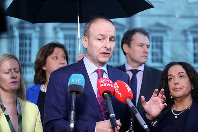 Is Micheál Martin telling us if his party stands candidates in the North, and they are successful, they will take the Oath to the English Queen?