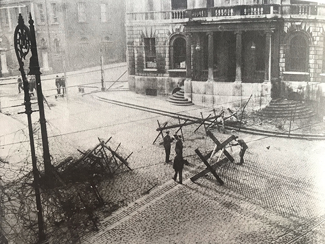 British Army surrounding City Hall with barbed wire barricade after they occupied it on 20 December 1920