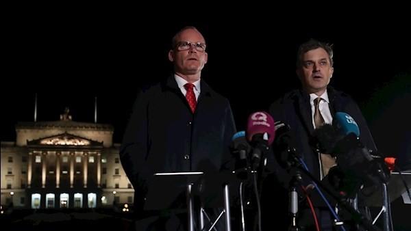 Simon Coveney and Julian Smith.