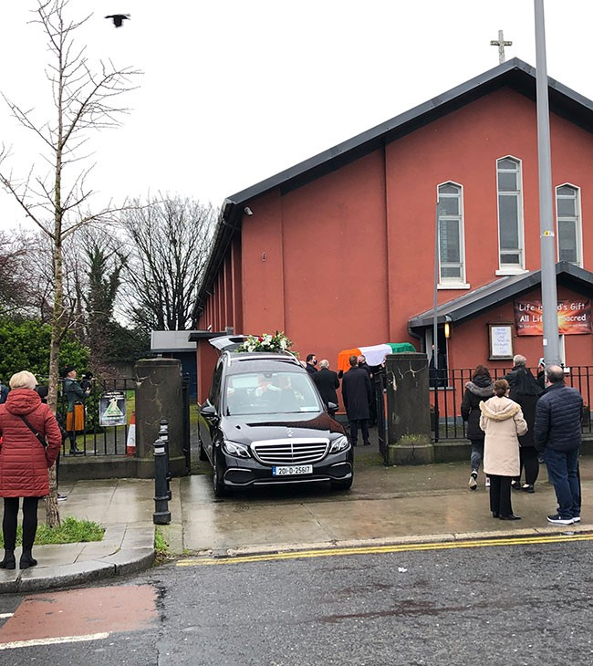Hughie's coffin leaving church