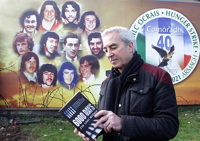 Former Hunger Striker and Blanketman Pat Sheehan with a copy of 6,000 days