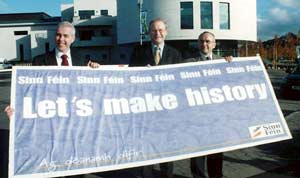 Dermot Kennedy, Martin McGuinness and Paul Butler hold up a Sinn Féin banner