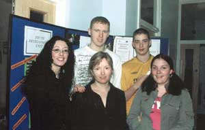 Tar Anall Youth Development Unit project coordinator Jeannette Keenan (front and centre) is pictured with some of the young people in the project who received certificates of achievement