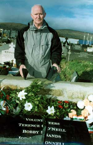 Liam Shannon stands over the desecrated graves