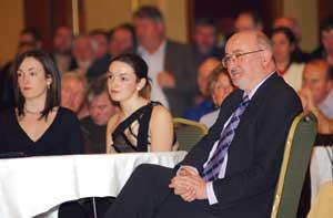 Caoimhghín Ó Caoláin listens on with daughters Sinéad and Cliodhna