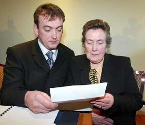Sean Brown's son Damien and widow Bridie examine the ombudsman's report on Monday
