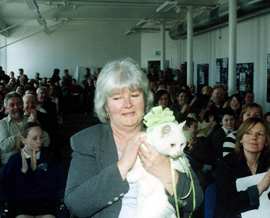Elsie Best received a lifetime achievement award for her years of service to the Conway Mill project, pictured with the Mill's feline in residence, Saoirse