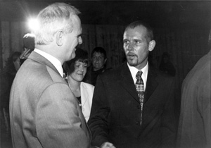 The DUP's Willie McCrea is pictured greeting loyalist killer Billy Wright
