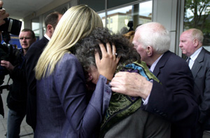 Annie Massey, whose daughter was killed, is comforted by members of her family after the inquest verdict was delivered