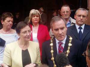 Gearóid Ó hEára, flanked by party colleagues, talks to the media after being elected Mayor of Derry
