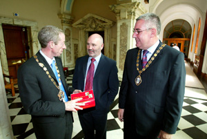Joe O'Donnell (right) pictured at Belfast City Hall with party colleagues Gerry McHugh, chair of Fermanagh District Council and former Belfast Mayor Alex Maskey