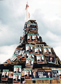 A loyalist bonfire at Stoneyfort bedecked with Sinn Féin election posters