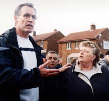 Sinn Féin MLA Gerry Kelly appeals for calm as the PSNI overturned the Parades Commission ruling. He later had an arm broken by a baton as he tried to calm the situation.
