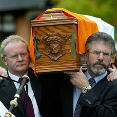 Gerry Adams and Martin McGuinness carry Joe Cahill's coffin