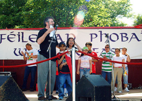 Gerry Adams on stage at the Féile Carnival with members of Belfast's Filipino community