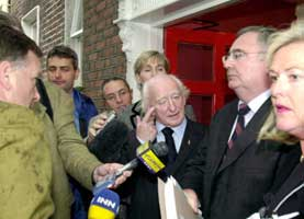 Michael D Higgins and Pat Rabbitte. Michael's gesture says it all!