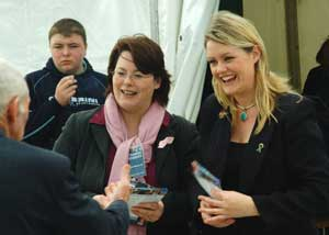 Fermanagh/South Tyrone MP Michelle Gildernew and Kerry Councillor Toireasa Ní Fhearaíosa chat with visitors to the Sinn Féin marquee