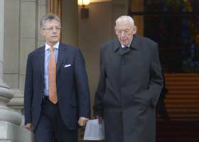Peter Robinson and Ian Paisley are pictured leaving Government Buildings in Dublin