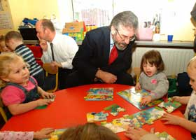 Gerry Adams discusses the issues of the day with young patrons of the community creche in Ringsend, Dublin