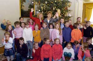 Children from the Chernobyl Children's project, along with Adi Roche, are pictured with Mary McAleese on their visit to Áras an Uachtarán in December