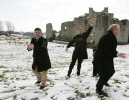 Joe Reilly, Gerry Adams and Martin McGuinness enjoy the snow on the campaign trail in Trim