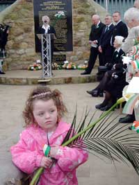 A young republican holds an Easter lily, as Annie Cahill addresses the crowds