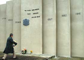 Dublin Chairperson Justin Moran lays a wreath at the Republican Plot in Glasnevin Cemetery
