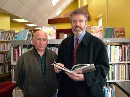 Gerry Adams with James McKeown in Carnlough Library, which the party is campaigning to save from closure