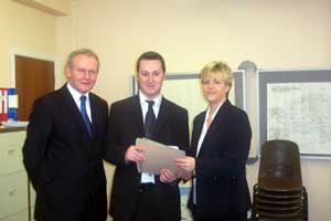 Philip McGuigan was accompanied by Martin McGuinness when he handed in his nomination papers