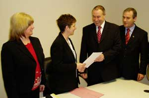 Mitchel McLaughlin (second right) hands in his nomination papers