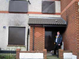 Feilim Mac Críosta outside a boarded up council house in Clondalkin