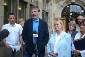 Gerry Adams with families of suicide victims and Belfast community workers after the meeting with the British minister
