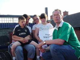 Gerry Kelly with Seán Kelly's family in North Belfast