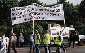 """Loyalists sending out a message to nationalist residents. It reads: """"Our flags are not those of murder gangs. They are flags of the men who died fighting for their country in which you live."""""""