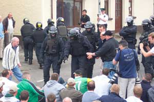 PSNI manhandle nationalist protestors in Dunloy (above)
