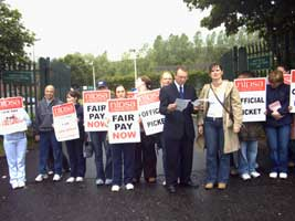 Michael Ferguson and other Sinn Féin activists protest against education cuts