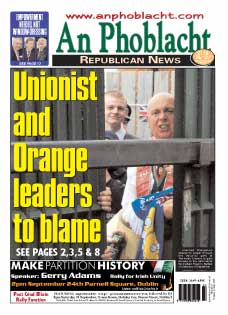 Frenzied Orangemen attempt to smash through the security gate at Workman Avenue to gain access to the nationalist Springfield Road in Belfast on Saturday 10 September