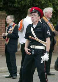 Orange marcher displays his 'culture' - note his fly!