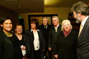 Mary Lou McDonald (far left) meets community activists with Christy Burke (glasses centre) and Gerry Adams (right)