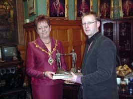Alan McBride being presented by Sinn Féin mayor of Derry, Lynn Fleming on behalf of council